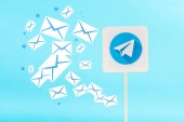 card with telegram logo and e-mail icons isolated on blue
