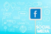 card with facebook logo and social media illustration isolated on blue