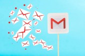 card with gmail logo and e-mail icons isolated on blue