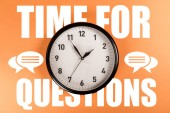 Fotografie round clock with white time for questions lettering and speech bubbles on orange background
