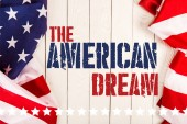 Fotografie top view of american flags and the american dream lettering on white wooden surface