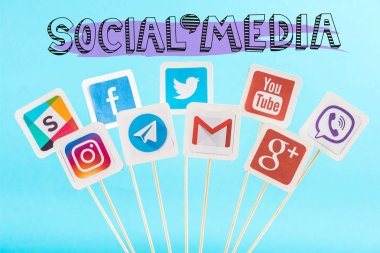 Social media lettering and icons isolated on blue stock vector
