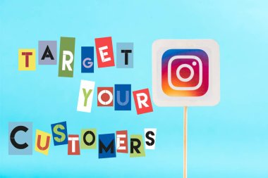 card with instagram logo and target your customers lettering isolated on blue
