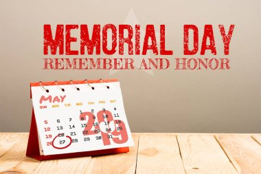 Calendar with 27th May 2019 date isolated on beige with memorial day red lettering stock vector