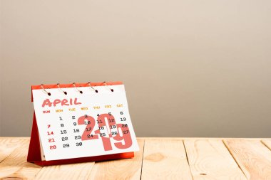 calendar with April 2019 page isolated on beige with copy space