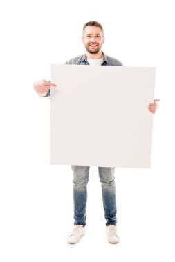 Full length view of smiling bearded man holding blank placard isolated on white stock vector