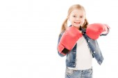 front view of smiling kid in red boxing gloves isolated on white