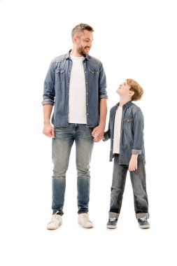 Full length view of smiling son and father holding hands isolated on white stock vector