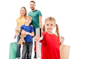 Smiling family with shopping bags isolated on white stock vector