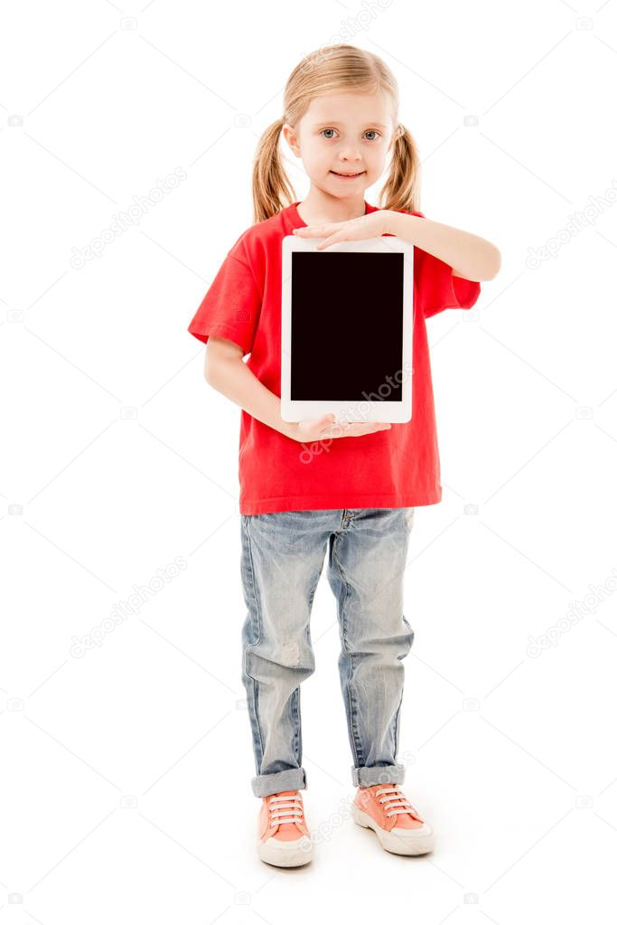 Full length view of smiling child in red t-shirt holding digital tablet with blank screen isolated on white stock vector