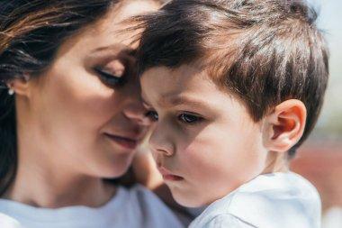 Selective focus of cute boy near caring mother stock vector