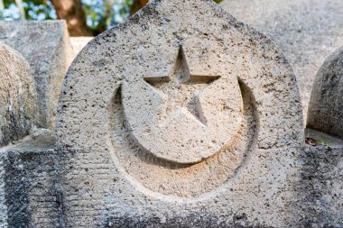 Turkish flag is engraved on a ancient stone in bodrum castle