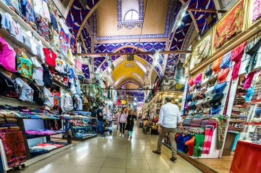 Unidentified people visiting the Grand Bazaar for shopping,Interior of the Grand Bazaar with souvenirs  in  Istanbul, Turkey.April 17, 201