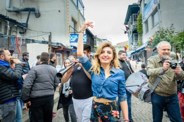 Unidentified woman dances to celebrate Hidirellez Festival.It means arrival of spring and celebrated throughout the Turkic world.Istanbul,Turkey.05 May 2018