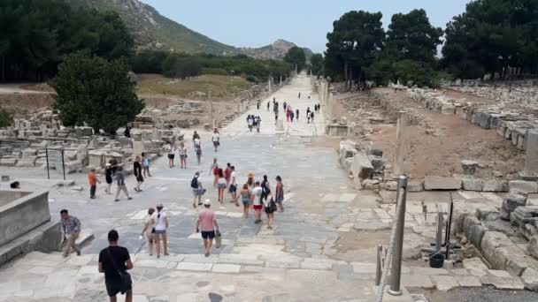 Selcuk, Izmir, Turkey - 20 August, 2017: People visit ancient ruins at Ephesus historical ancient city