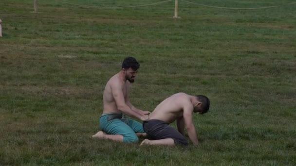 ISTANBUL,TURKEY - May 13, 2017: Unidentified people perform shalwar(shalvar or salvar) guresi, (kuroshio/wrestling). Salvar wrestling is a kind of traditional Turkish wrestling.