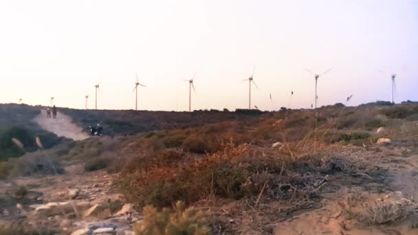 time lapse of Wind tribunes, windmills on the sunset view