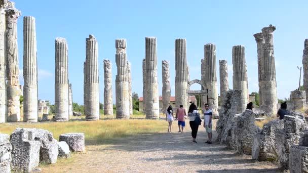 Unidentified tourists walking and exploring Zeus temple at Uzuncaburc Ancient city located in Uzuncaburc, Silifke, Mersin, Turkey. 29 August, 2017.