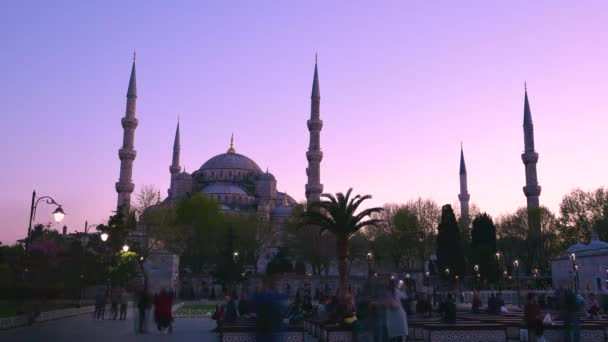 Time lapse:Unidentified people take pictures in front of Sultanahmet Mosque or Blue Mosque on background in Istanbul, Turkey. 21 April, 2018.