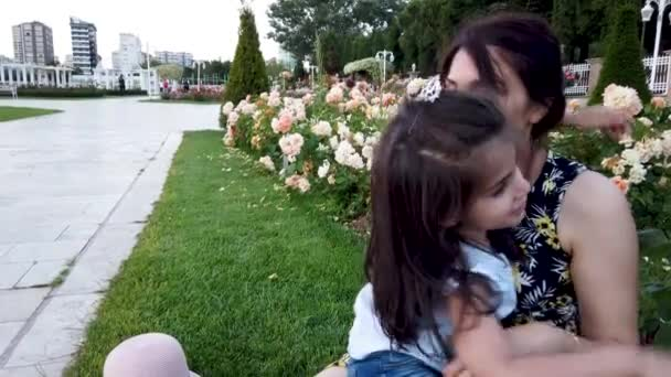 Slow motion:Mum and daughter spends time and enjoys together in the park