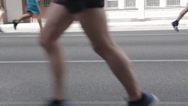 19.05.2019 Tet Riga Marathon Latvia : Marathon Runners Crowd Front  View Legs. Athletes Runing Out Off Focuss. Blurred Runner Feet Running Marathon.
