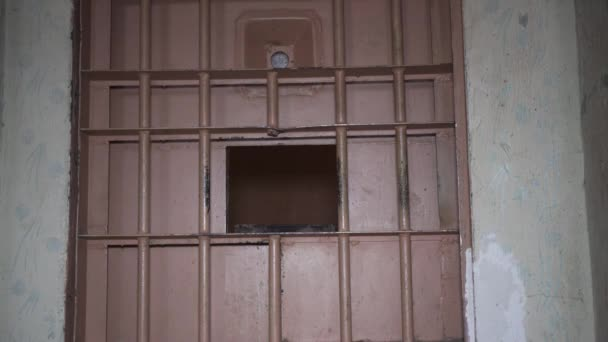 Prison Metal Door Protect Prisoner From Inside to Escape. Food Channel Through Prison Cells Bars. Jail, Detail of Confinement and Crime, Justice. Prison Interior. Limiting Freedom.