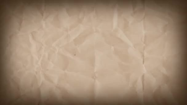 Abstract Grunge Kraft Paper Textured Background Loop/ 4k animation of a vintage motion graphic with grunge torn paper textures seamless looping
