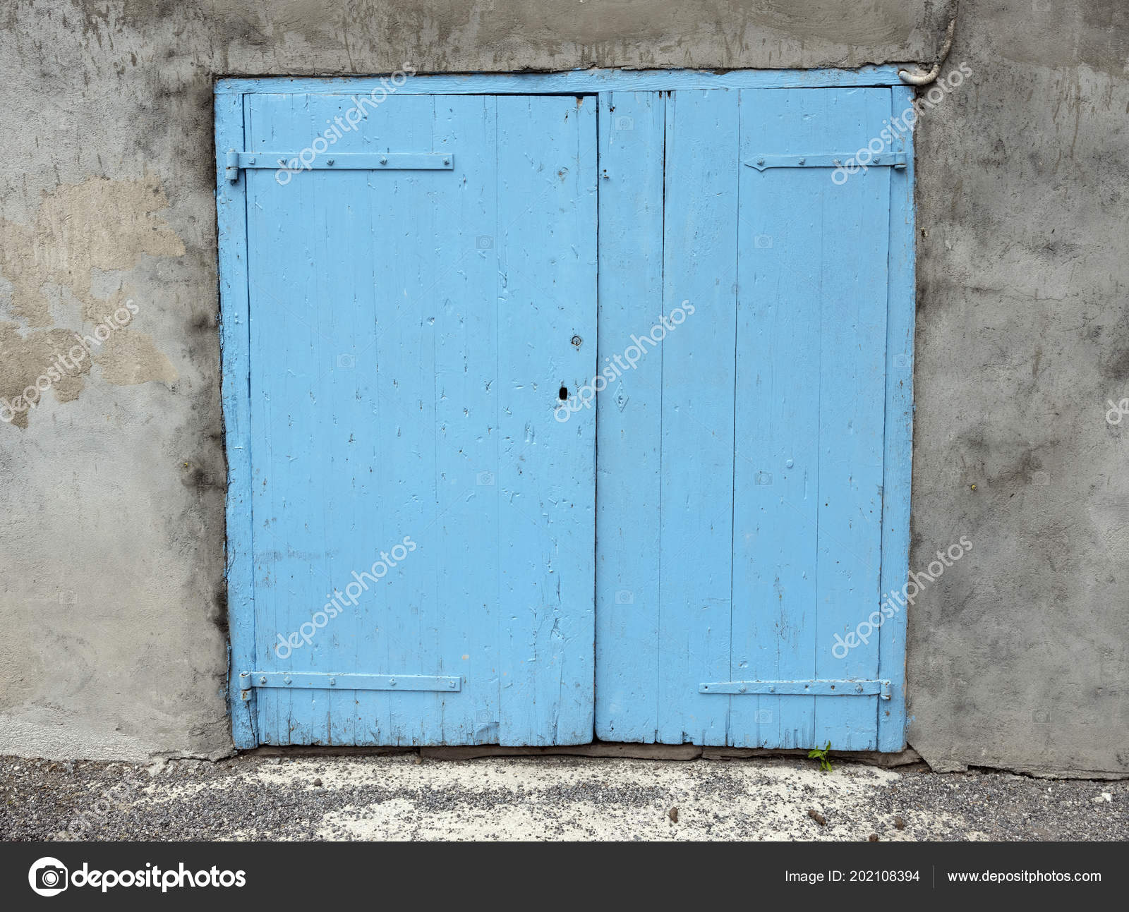 Old Blue Doors Shutters In Wall Of House In French Provence Stock