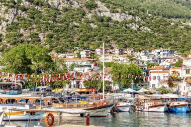Kas, Turkey, 05/16/2019: A beautiful resort town with a marina on a bright sunny day.