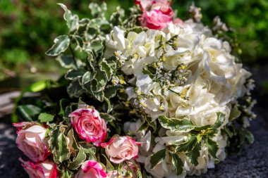 Delicate bouquet of the bride in nature. Holidays and events. Close-up.