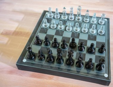 Chess pieces on the board during the game,chess made from glass,selective focus