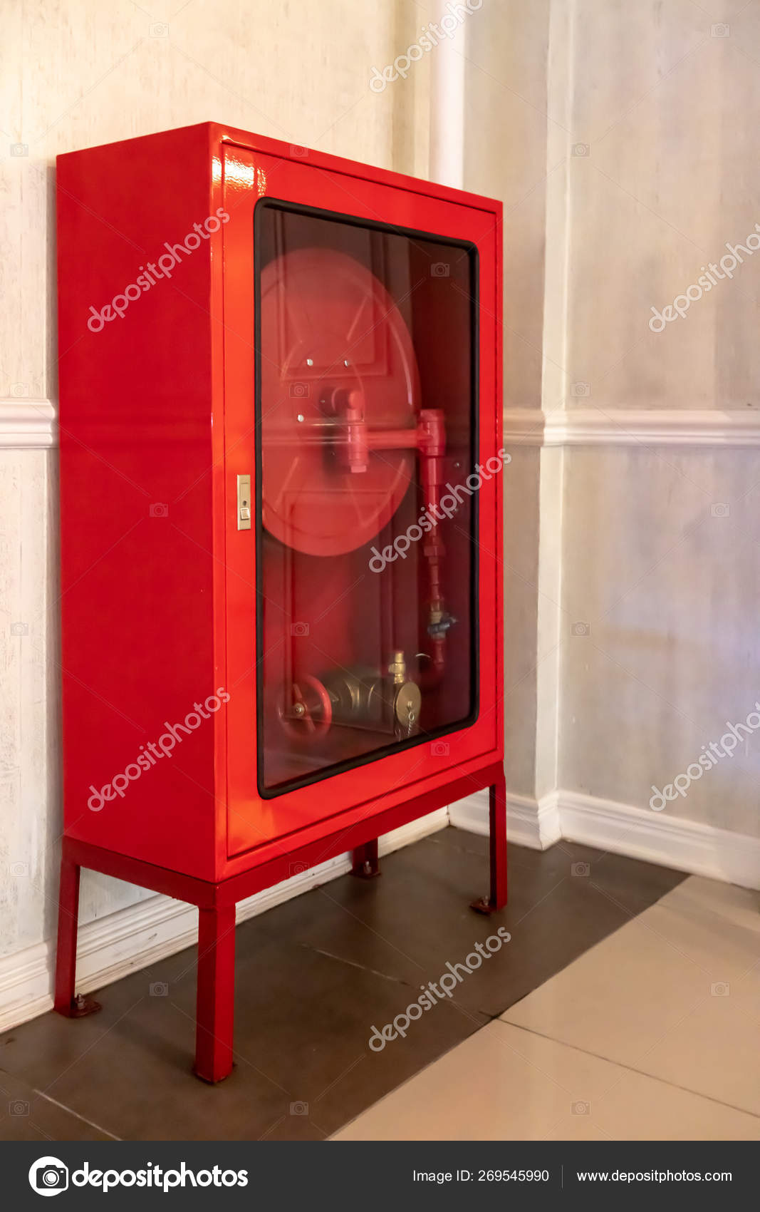 Red Fire Hose Cabinet On Brown Tile Floor Against White Wall Stock Photo C V74 269545990