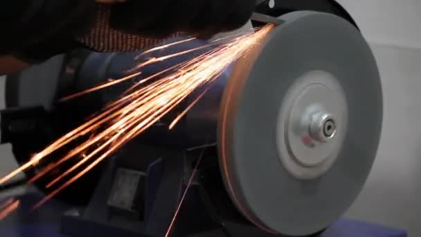 Working on a bench grinder