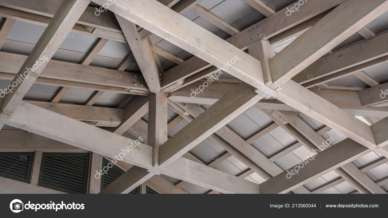 white wood ceiling framework against a white roof stock photo - White Wood Ceiling