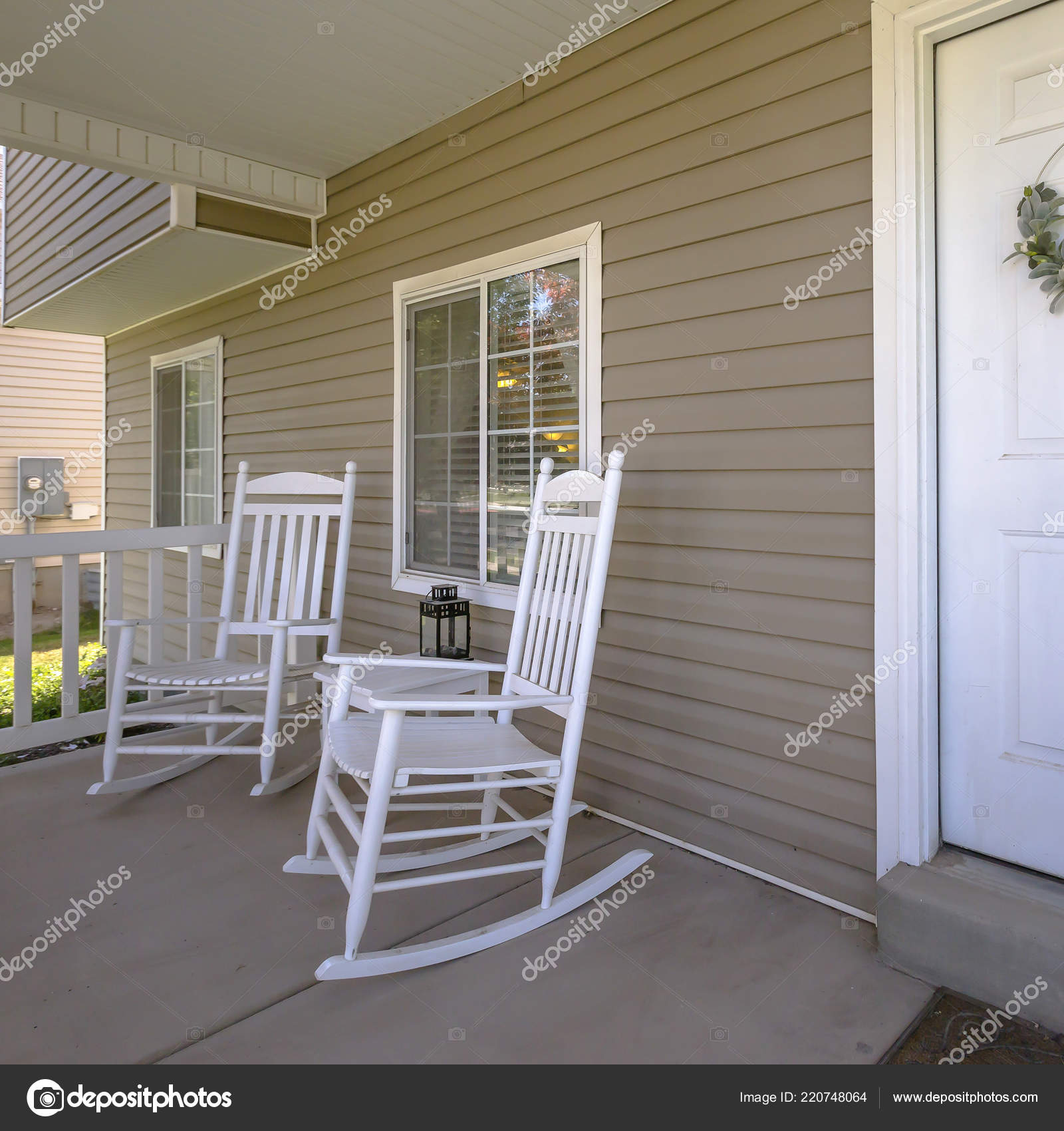 Incredible Home With Rocking Chairs And Table On The Porch Stock Creativecarmelina Interior Chair Design Creativecarmelinacom