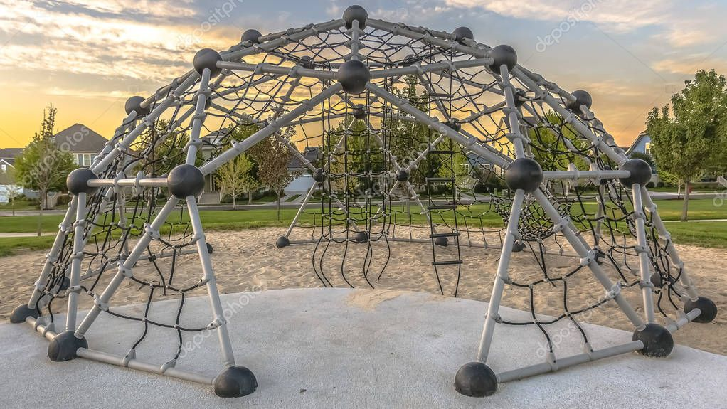 Playground with geometric dome rope climbing frame