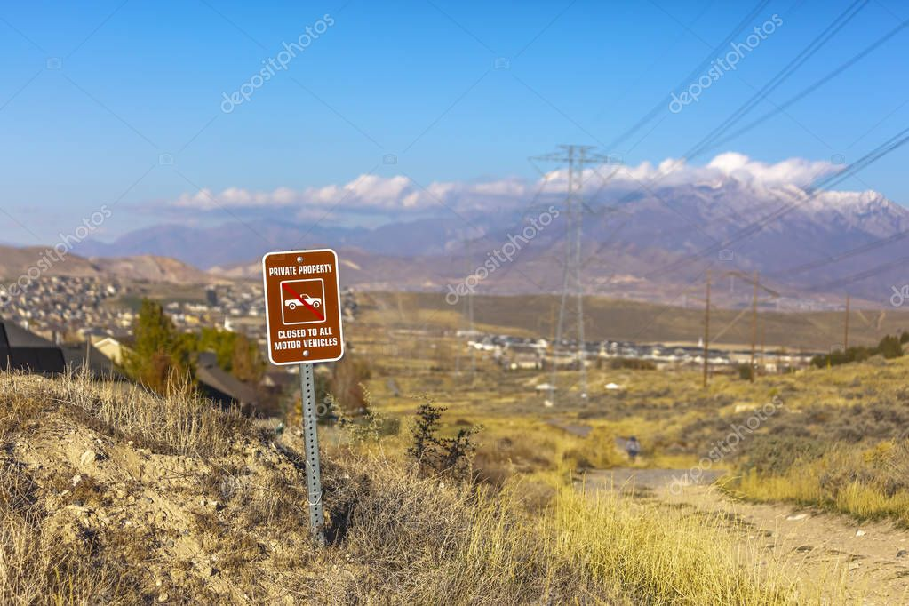 A sign prohibiting vehicles with Timpanogos view
