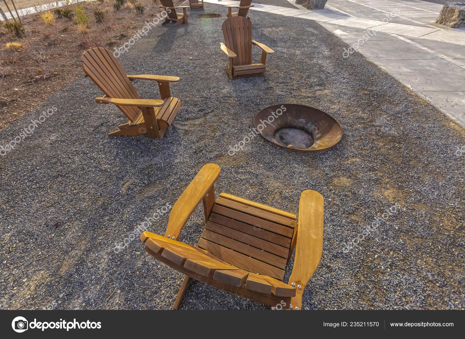 Sensational Wooden Chairs Sitting Around A Fire Pit In Park Stock Machost Co Dining Chair Design Ideas Machostcouk