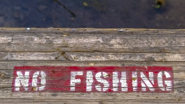 Wooden platform with painted No Fishing sign