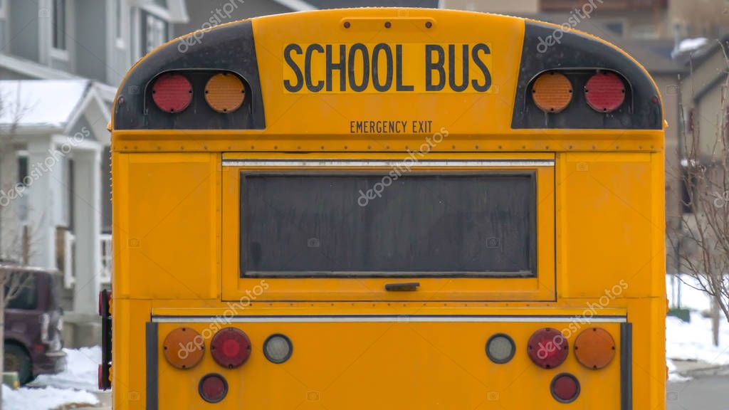 Clear Panorama Yellow school bus with rectangular window and several signal lights at the rear