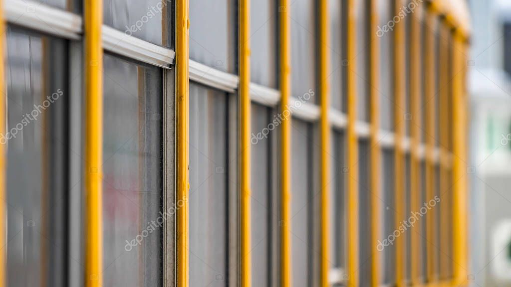 Panorama Exterior view of a yellow school bus with a close up on the glass windows