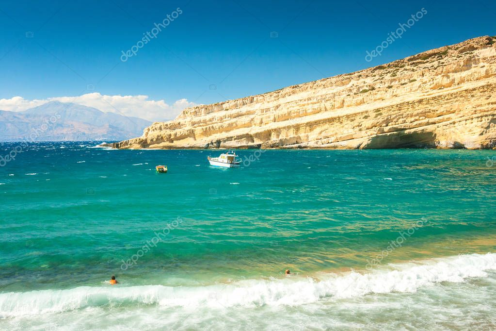 Matala beach and cliff with caves on the island of Crete, Greece, Europe.