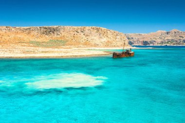 Rusting shipwreck at the seaside near The Balos lagoon at northwest from island of Crete, Greece.
