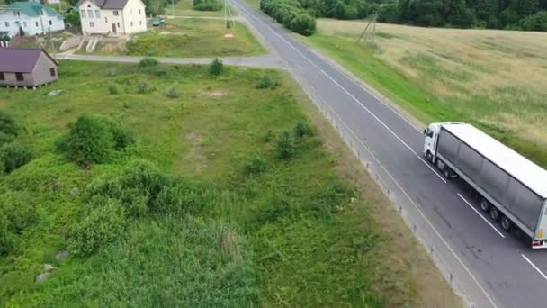 Container truck driving on the road in the countryside