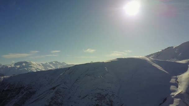 Mountains in winter in Georgia. Caucasus and bright sun. Panorama of the mountains
