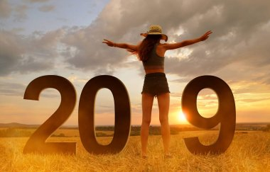 Joyful girl in celebration of the New Year 2019.