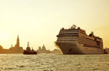 VENICE, ITALY - September 15, 2018 : Cruise ship MSC Poesia sailing through the canal at sunset.