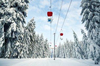 Snowy winter landscape in the National park Sumava, cableway on mount Pancir, Czech Republic.