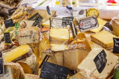 Aix-en-Provence, FRANCE, on March 6, 2018. Various farmer French cheeses are laid out on counters of the well-known Cours Saleya market