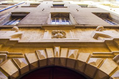 Aix-en-Provence, FRANCE,6 of March, 2018. The sun lights a facade of the old building